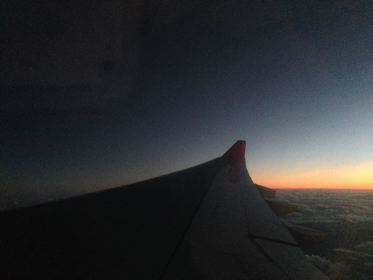 Cropped Image Of Airplane At Dusk