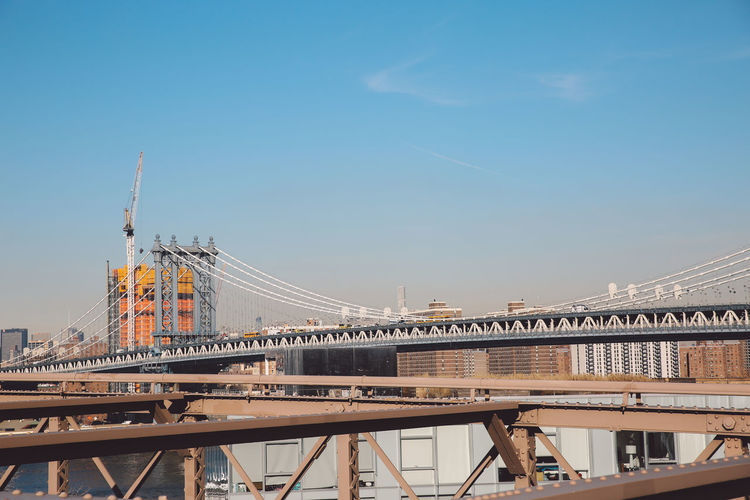 Manhattan Bridge Against Blue Sky On Sunny Day In City