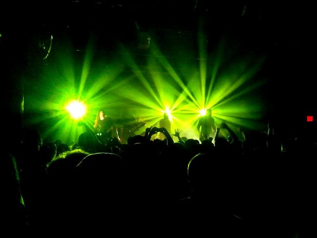 At the rockshow Concert Rockshow  Metal Music In Flames Performance Green Color Light Show Crowd Venue Woolys Des Moines, Iowa Adventure Club