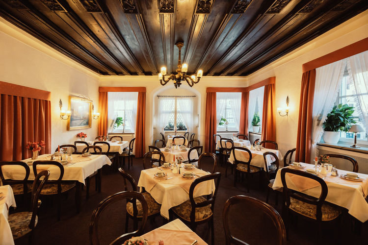 Breakfast room of Hotel Adler in Ingolstadt Ingolstadt Hotel Adler Travel Historic Indoors  Seat Table Chair Architecture Furniture Wealth Window No People Absence Ceiling Lighting Equipment Luxury Restaurant Home Interior Business Illuminated Chandelier Wood - Material Empty Electric Lamp Ornate Dining