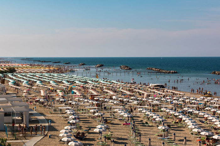 Beach section in Torre Pedrera at Rimini in Italy Adria Strand Urlaub Architecture Baden Beach Building Exterior Built Structure Chair Crowd Day Group Of People High Angle View Horizon Horizon Over Water Land Large Group Of People Nature Outdoors Sea Sky Torre Pedrera Trip Vacations Water