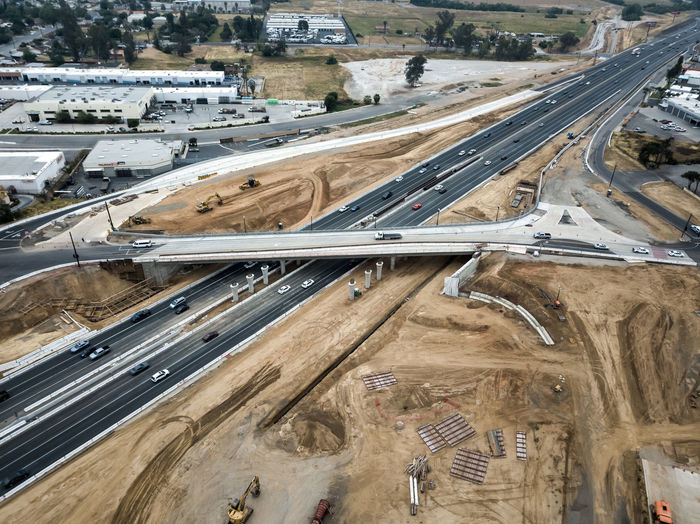 Grand Terrace, CA / USA - 4/21/2019: The Barton Road / 215 Interchange Under Construction Transportation Road High Angle View No People Architecture Built Structure Aerial View Day Construction Interchange  Bridge Road Highway Freeway Mode Of Transportation Car Land Vehicle Connection Multiple Lane Highway Elevated Road Motor Vehicle City Bridge - Man Made Structure Nature Outdoors Overpass