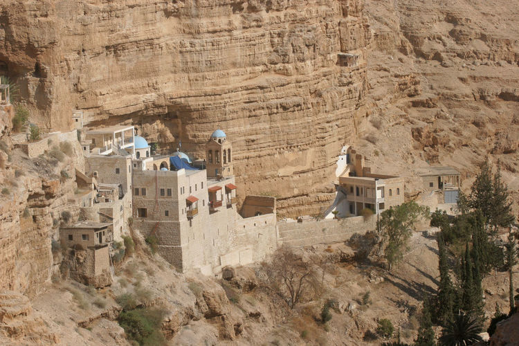 Saint George monastery in Judea desert, Israel Abbey Architecture Building Exterior Canyon Church Cliff Desert George Israel Judea Middle East Monastery Mountain Nature Palestine Religion Rock Sand Sandstone Stone Valley Wilderness Worship