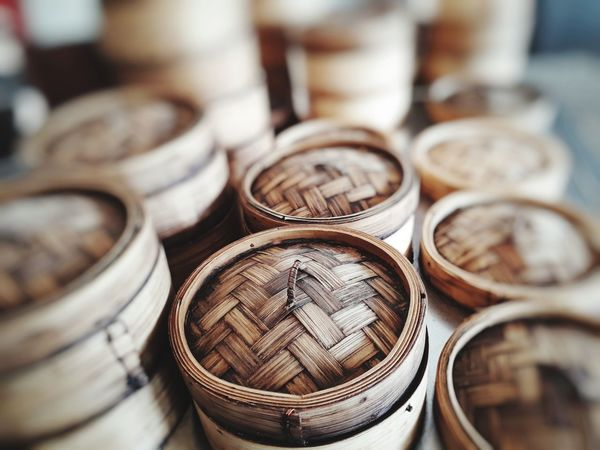 Dim Sum is the steamed food of the Chinese people Coin Stack Business Wealth Arrangement Close-up For Sale Flea Market Shop Window Display Collection Shelves Retail Display Farmer Market Stall Money Display Market Stall Fish Market Price Tag Market Various