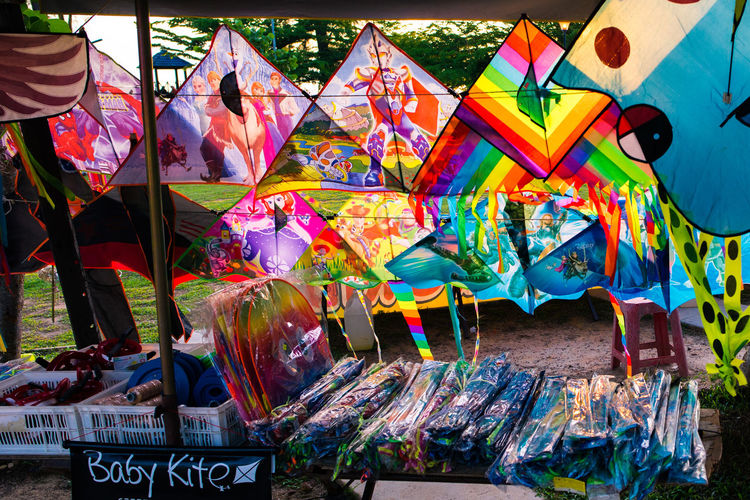 Colorful kites at market for sale