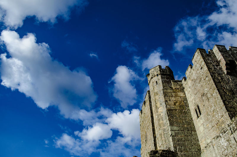 Low angle view of castle against blue sky