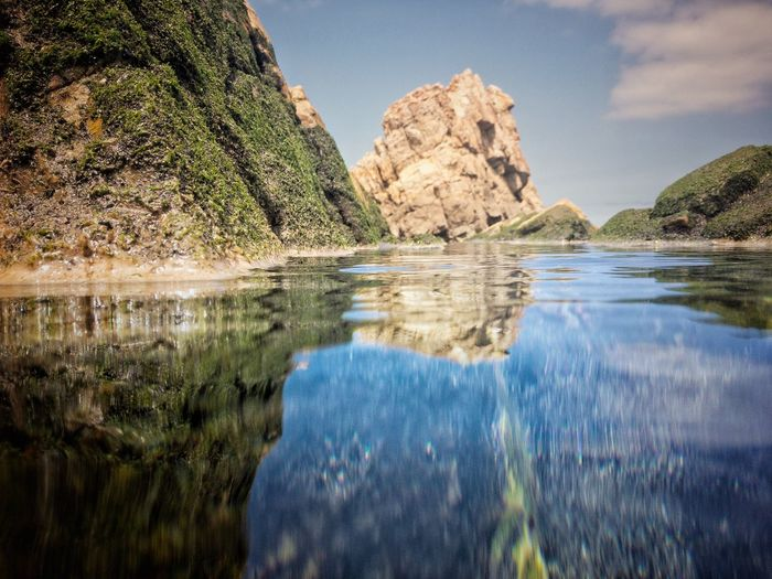 Water Reflection Beauty In Nature Scenics - Nature Tranquility Sky Tranquil Scene Nature Rock Day No People Waterfront Idyllic Rock Formation Rock - Object Solid Outdoors