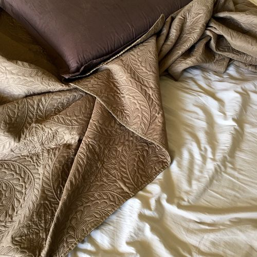 High angle view of sheet and pillow on bed
