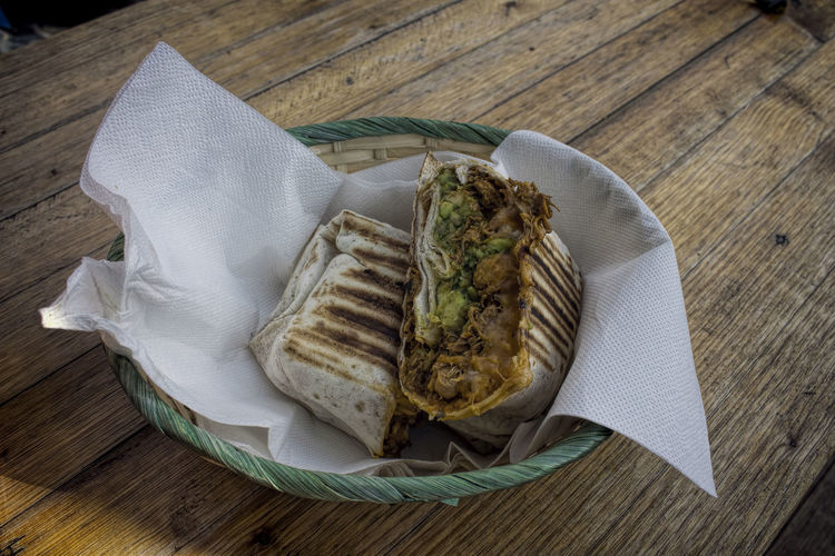 High Angle View Of Burrito On Wooden Table