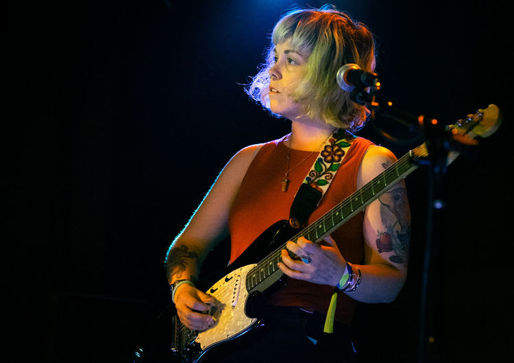Maggie May - Genders Woman Female Musician Musician Black Background Popular Music Concert Illuminated Electric Guitar Performance Beauty Nightlife Music Arts Culture And Entertainment Rock Musician Rock Music Singer  Music Concert