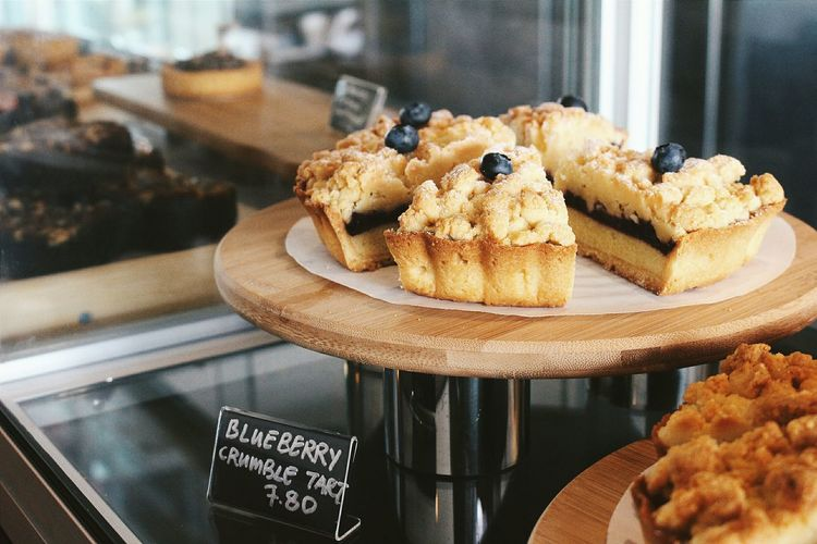 High angle view of blueberry tart in shop