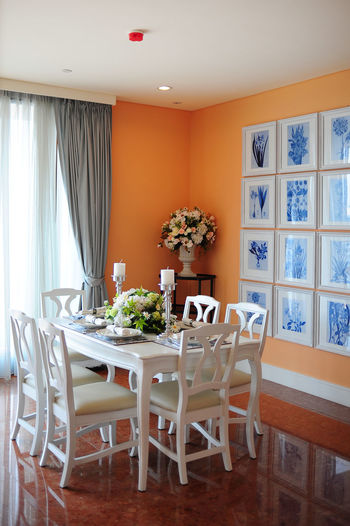 Home interior with dinning table and chairs