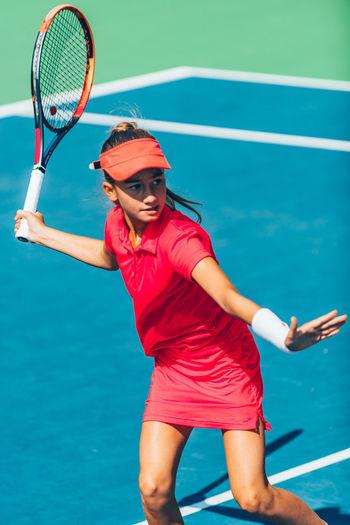 High angle view of girl playing tennis