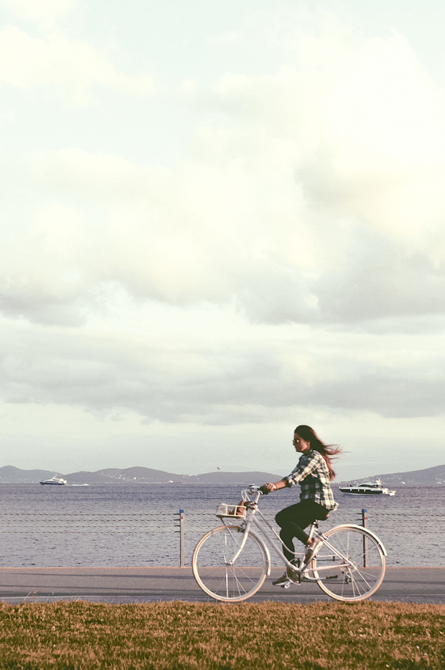 bicycle, sky, cycling, sea, one person, outdoors, riding, nature, cloud - sky, horizon over water, men, water, scenics, sport, day, real people, one man only, only men, people, drone