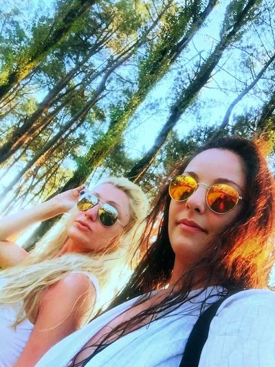Hello World Us Women Blonde And Brunette Sunglasses In Nature  Long Trees Green Green Green!  Summertime Sky Friends Walking Life Is Beautiful Resting Relax Holidays