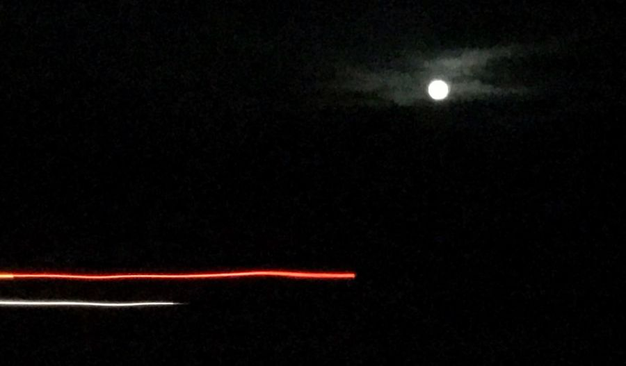 Almost full moon on highway 95 south Illuminated Moon Night Time Car Lights Highway Darkness Night Illuminated Moon Red No People Outdoors Sky