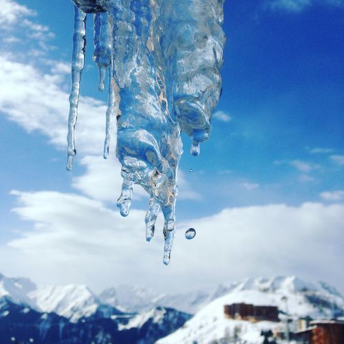 Close-Up Of Icicle Against Blue Sky