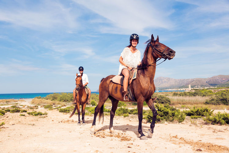Couple Fun Happy Rider Saddle Tourist Action Activity Animal Activity Beach Day Domestic Animals Horse Horseback Riding Lifestyles Mammal Men Outdoors People Riding Sea Sports Tourism Women Young Adult