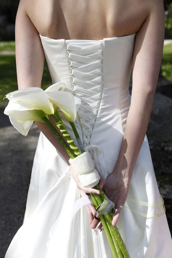 Adult Calla Calla Lily Close-up Day Flower Holding Human Body Part Life Events Midsection One Person One Woman Only Only Women Outdoors People Standing Wedding Ceremony Wedding Dress