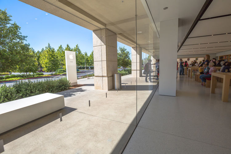 Cupertino, California, United States - August 15, 2016: the Apple world headquarters at One Infinite Loop. Apple is a multinational that produces consumer electronics, personal computers and software. people come from the popular Apple store of Apple Inc Headquarters at One Infinite Loop located in Cupertino, Silicon Valley, California. Apple California IT Mac PC United States Architectural Column Architecture Building Built Structure Computer Cupertino Day Electronics Industry Flag Headquarter Headquarters Hq IMac27 IPhone Imac Indoors  Infinite Loop Mobile No People Sky Store Tree