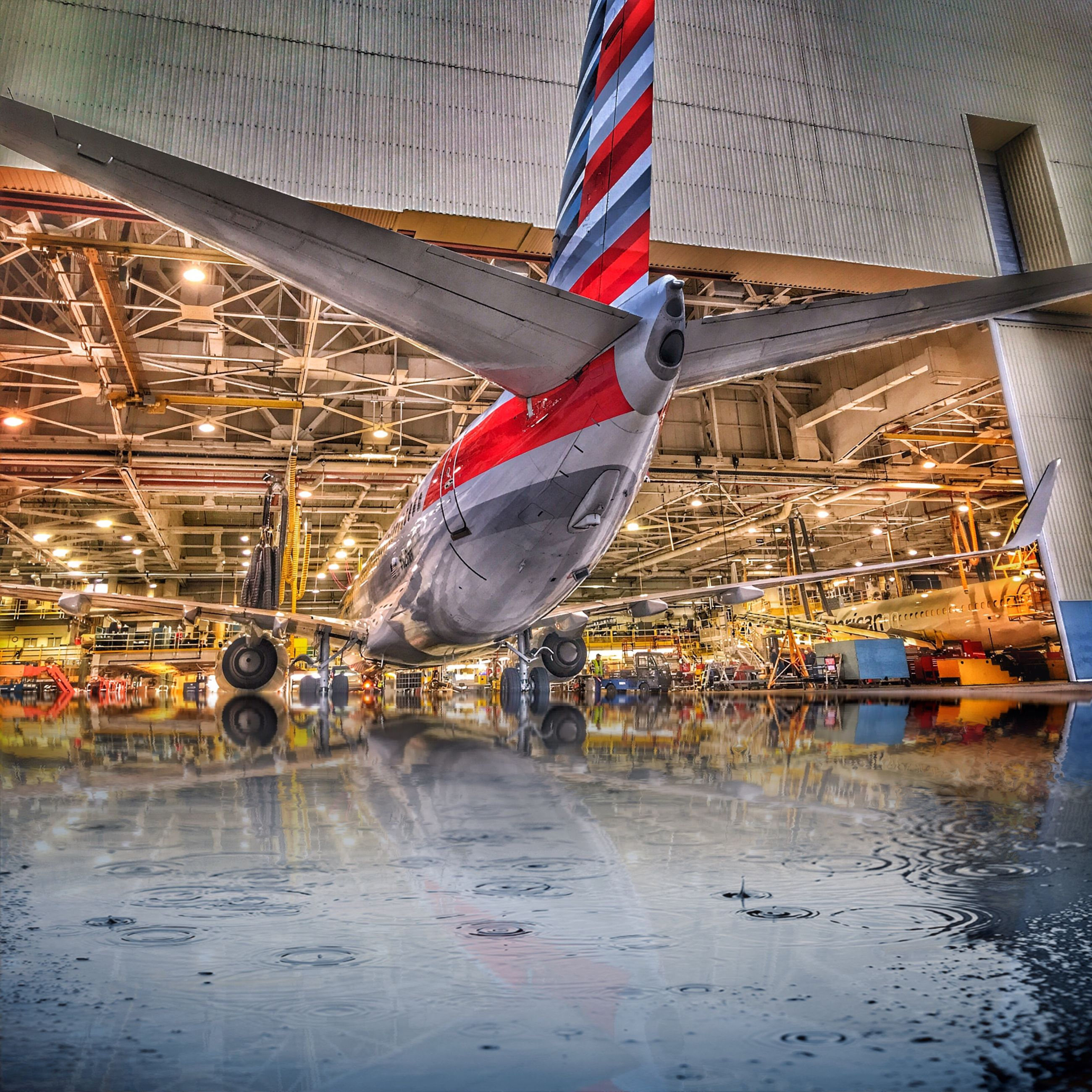 transportation, mode of transport, airplane, flag, patriotism, water, air vehicle, built structure, no people, architecture, day, outdoors