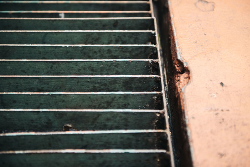 close up image of old steel grating with blurred weathered concrete floor for drainage with waste as old sewer for drainage concept. Architecture Backgrounds Concrete Wall Drainage Drainage Channel Drainage, Draining Draining Pattern Sanitary Steel Grating Waste Leaf Weathered Wood