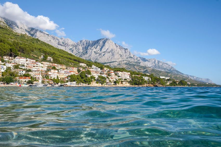 City Cityscape Coastline Copy Space Mediterranean Culture Panoramic Panoramic View Turquoise Colored Adriatic Sea Beauty In Nature Biokovo Blue Building Exterior Landscape Mountain Mountain Range Nature No People Outdoors Scenics Sea Sky Tourism Water Waterfront