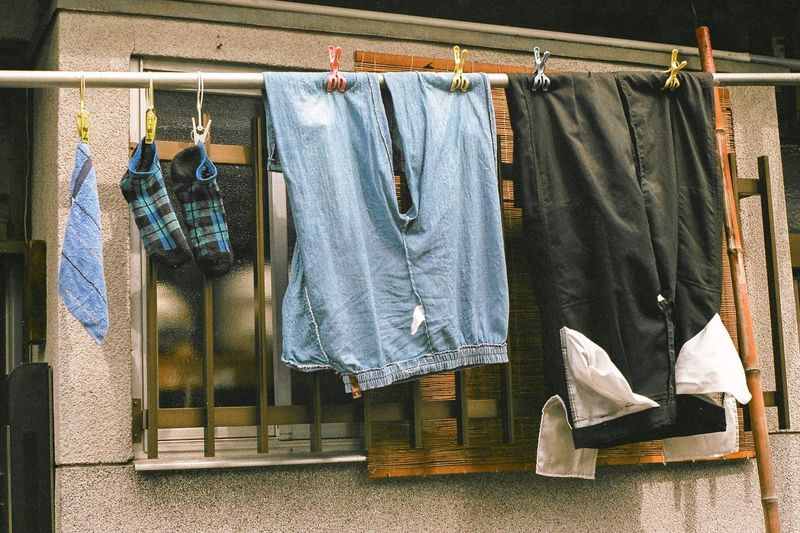 Clothes Drying On Clothesline Against Window