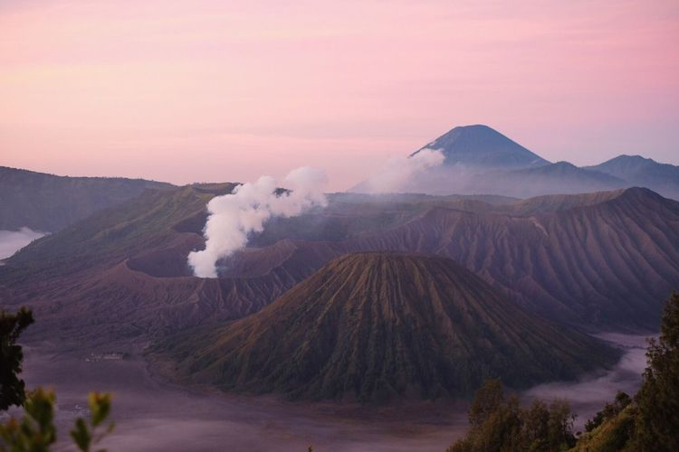 View of volcanic mountains during sunrise