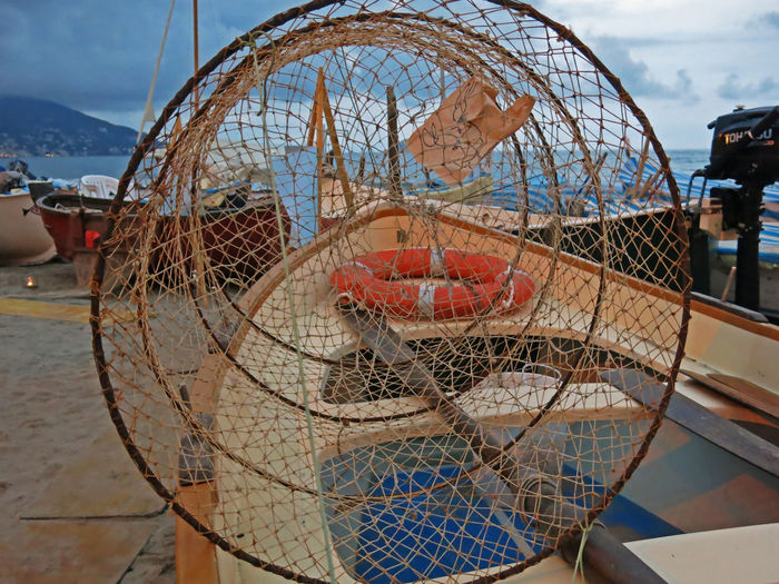 Beach Photography Boats⛵️ Circle Cloudy Fish Traps Oar Seascape Photography September Beach Boat Boats Circles Close-up Day Fish Trap Fishing Fishing Boat Fishing Net Laigueglia Lifebelt No People Outdoors Seascape Sky Water