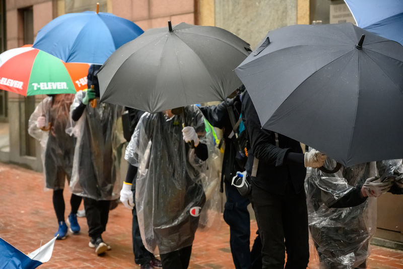 People walking with umbrella in city