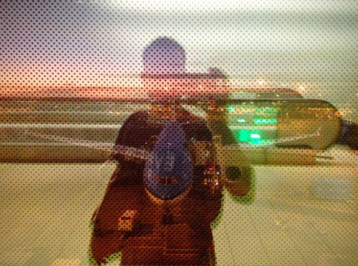 Multiple exposure of a man against airplane on runway