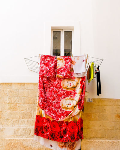 Low Angle View Of Clothes Hanging On Window