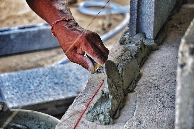 Close-up of man working at construction site