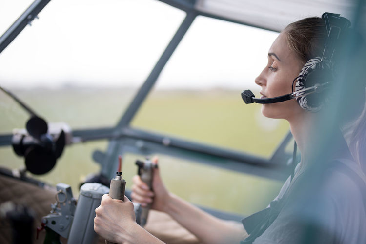 Female pilot sitting at the wheel of the plane