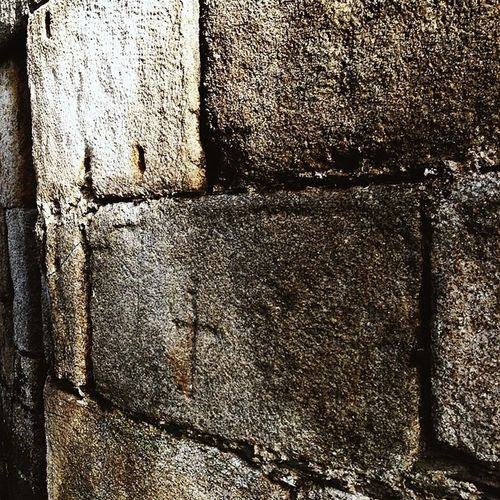 Cross carved into one of the bricks of the Porta Nova of Lugo's Roman Wall MurallaRomana Lugo Galicia