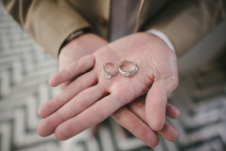 Midsection of bride holding wedding rings