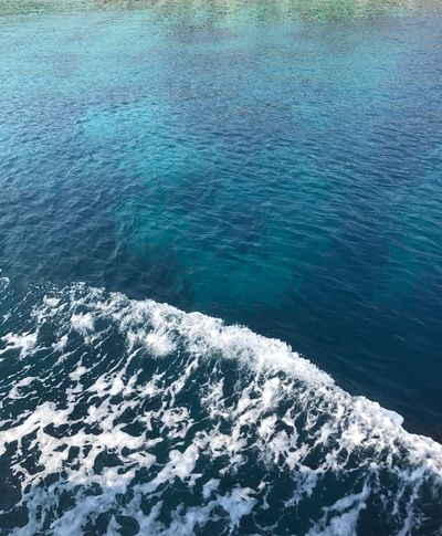 Water Sea High Angle View Nature No People Day Outdoors Blue Rippled Beauty In Nature Wave Wake Scenics Beauty In Nature Rock - Object Blue Water Clear Water Background Landscape Waterfront Sailing