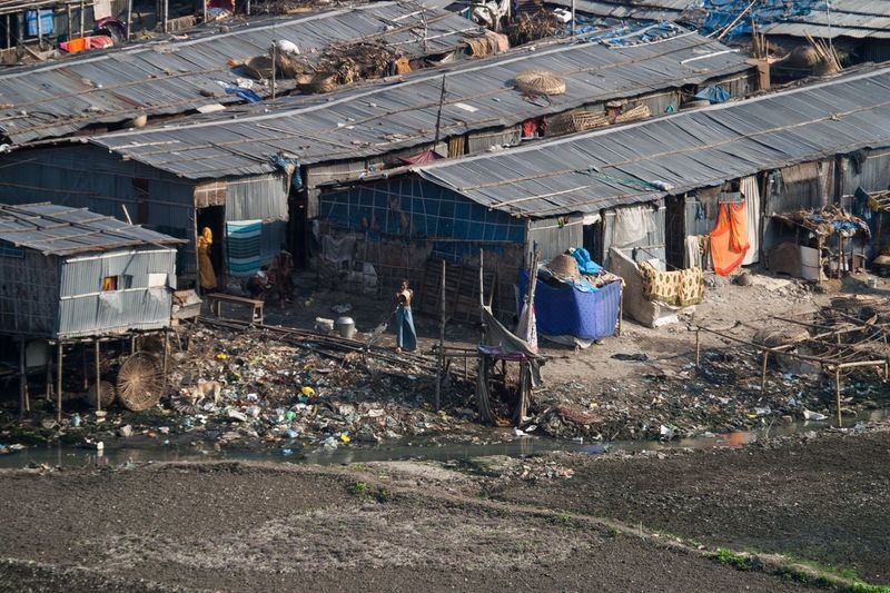 High Angle View Of Houses By Messy Sewage