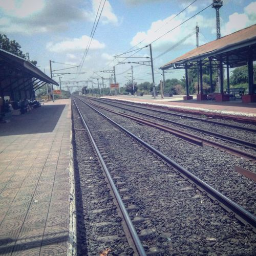 Sometimes the wrong train takes you to the right station. Railroad Track Rail Transportation Cable Transportation Cloud - Sky Sky Power Line  No People Day Public Transportation Outdoors Railroad Station Platform Railroad Station Power Supply Electricity Pylon Parallel Electricity  Nature