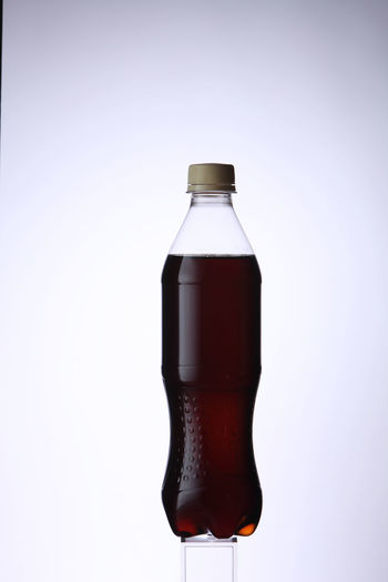 bottle of soft drink on the white background Isolated Bottle Clean Clear Close-up Cut Out Cut Out On White Drink Food And Drink Freshness Galss No People Object Refreshment Single Object Studio Shot Translucent Transparent White Background