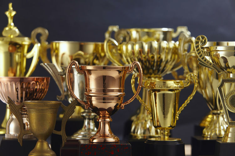 Close-up of trophies against black background