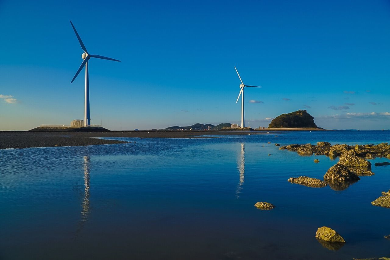 alternative energy, wind turbine, renewable energy, environmental conservation, wind power, fuel and power generation, windmill, industrial windmill, traditional windmill, water, no people, blue, nature, outdoors, technology, scenics, sky, rural scene, day, beauty in nature, tranquility, sea