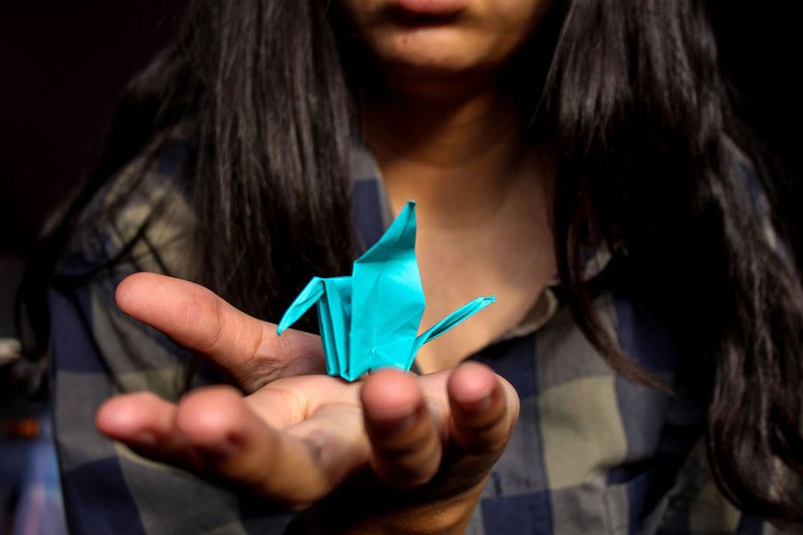 Adult Art And Craft Casual Clothing Close-up Crane - Bird Focus On Foreground Front View Hand Holding Leisure Activity Long Hair Midsection One Person Origami Origami Cranes Paper Real People Women