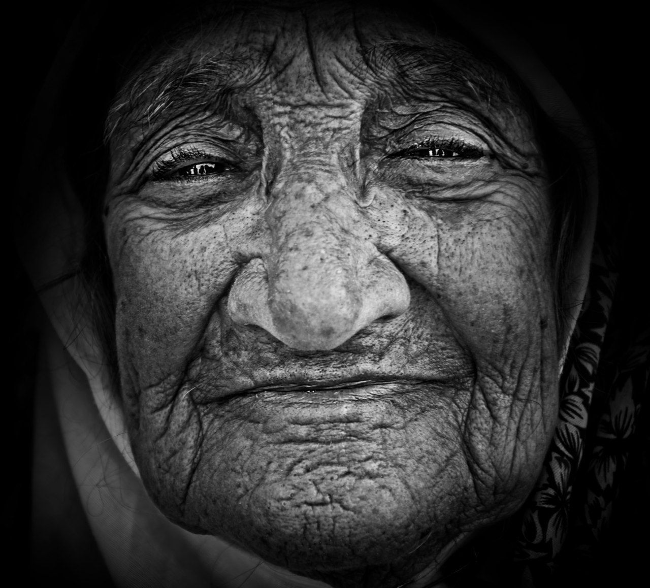 senior adult, wrinkled, human face, senior men, one person, one senior man only, real people, portrait, human body part, close-up, looking at camera, one man only, wisdom, men, night, black background, indoors, eyebrow, only men, adult, adults only, people