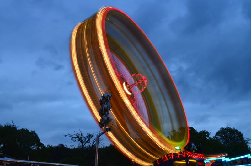 Amusement Park Amusement Park Ride Arts Culture And Entertainment Blurred Motion Cloud - Sky Day Dusk Enjoyment Excitement Fairground Ferris Wheel Leisure Activity Long Exposure Low Angle View Motion Nature No People Outdoors Sky Speed Spinning Tree