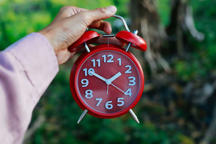 alarm clock Human Hand Hand Time Clock Human Body Part Number One Person Real People Close-up Holding Focus On Foreground Minute Hand Day Unrecognizable Person Body Part Alarm Clock Clock Face Accuracy Red Hour Hand Finger