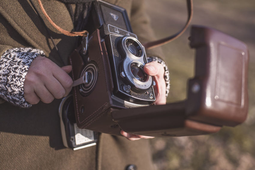 Analogue Photography Camera - Photographic Equipment Close-up Day Holding Human Hand Leisure Activity Lifestyles Men One Person Outdoors Real People Technology
