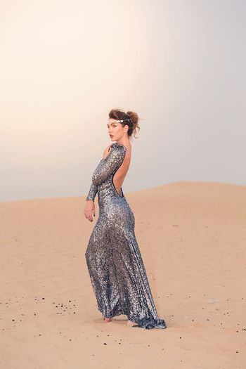 Sand One Person Young Adult Desert Sand Dune Real People Young Women Leisure Activity Portrait Beautiful Woman Nature Fashion Model Full Length Posing Smiling Day UAE Dubai Lifestyles Outdoors