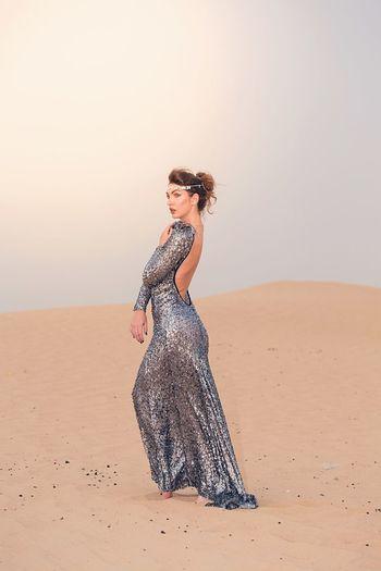 Female Model Posing At Desert Against Sky